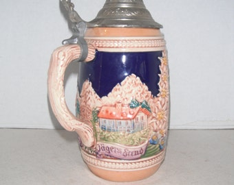 Vintage lidded beer stein, two men with feathered hats