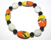 Glow in the Dark Orange Yellow Black Bracelet.  Halloween.  Candy Corn.  Glass beads