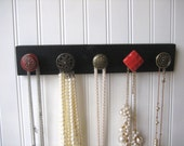 Jewelry Display Rack in Red and Brass on Black Painted Wood