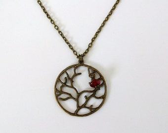 "Tree of Life necklace with a genuine carnelian bead hand wrapped. Antiqued bronze necklace about 18"" long"
