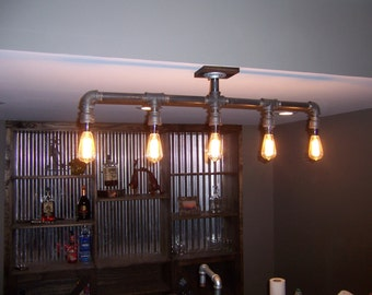 Iron pipe fixture with 5 Edison sockets