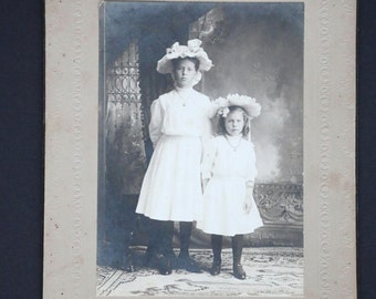 It's All About the Hats - Vintage Black and White Portrait Photograph of Two Young Girls, Marked Iveam Van Tasseleo Whitehall Wis.