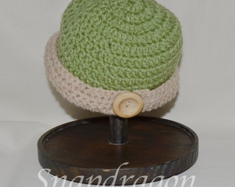 Green and beige crochet hat with wooden button sized 3 - 6 months