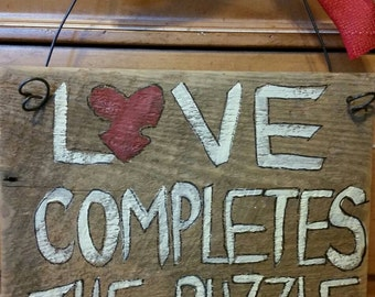 Love completes the puzzle sign. Autism awareness. Rustic