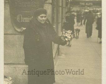 Woman flower seller by pharmacy antique UK photo by F.J. O'Brien
