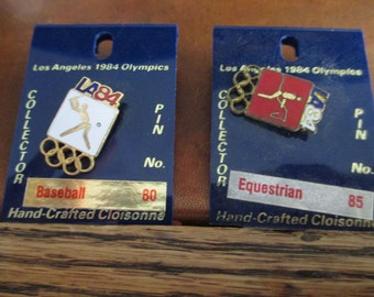 Two Los Angeles 1984 Olympic Hand Crafted Cloisonne on original cards - Equestrian and Baseball