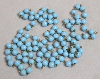 Pale Blue Beaded Necklace with Many Round Beads and Goldtone Links / Circa 1960s