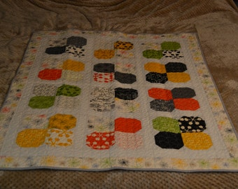 Quilted wall hanging or lap quilt. Machine pieced and quilted in beautiful comma by zen chick fabrics