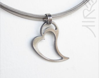 Heart necklace by Marsh Scott shown with a 18 inch steel choker. Pendant is stainless steel.
