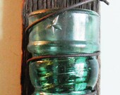Tea Light Holder Crafted from a Vintage Green Star Pony Insulator Wrapped in an Antique Bed Spring, Mounted to 100+ year-old Barn Wood