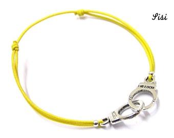 Silver cuff bracelet yellow cord