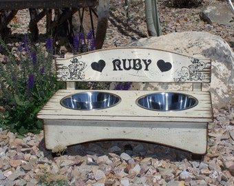 Personalized rustic wood dog feeder with stainless steel bowls. Comes in a variety of colors