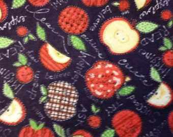 100 % Cotton Flannel Featuring Apples on a Dark Blue Background- By the Yard