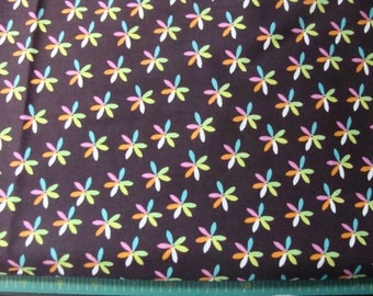 Joann fabrics daisey flowers greens, oranges, white and pink flowers on Chocolate Fabric