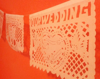 "3 Papel picado for wedding, in white color with the phrase ""OUR WEDDING"""