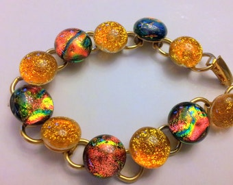 Dichroic glass bracelet yellow goldand autums colours 12 cabochons