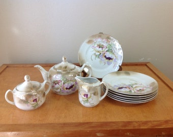Germany Porcelain Teapot with Cream and Sugar and 6 Plates Poppyseed Floral Design