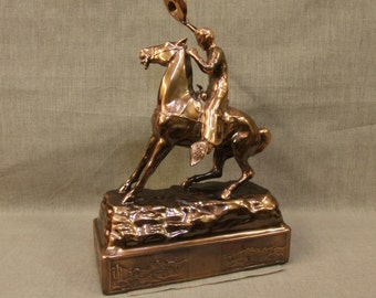 Rare copper cowboy on horse statue, mint warehouse