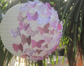 Indoor outdoor lantern half-filled with 2 color paper butterflies for weddings, parties