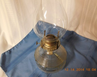 Oil lamp, clear glass.