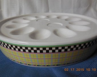 This deviled egg serving platter is by Sakura with a pattern in white, yellow, black.