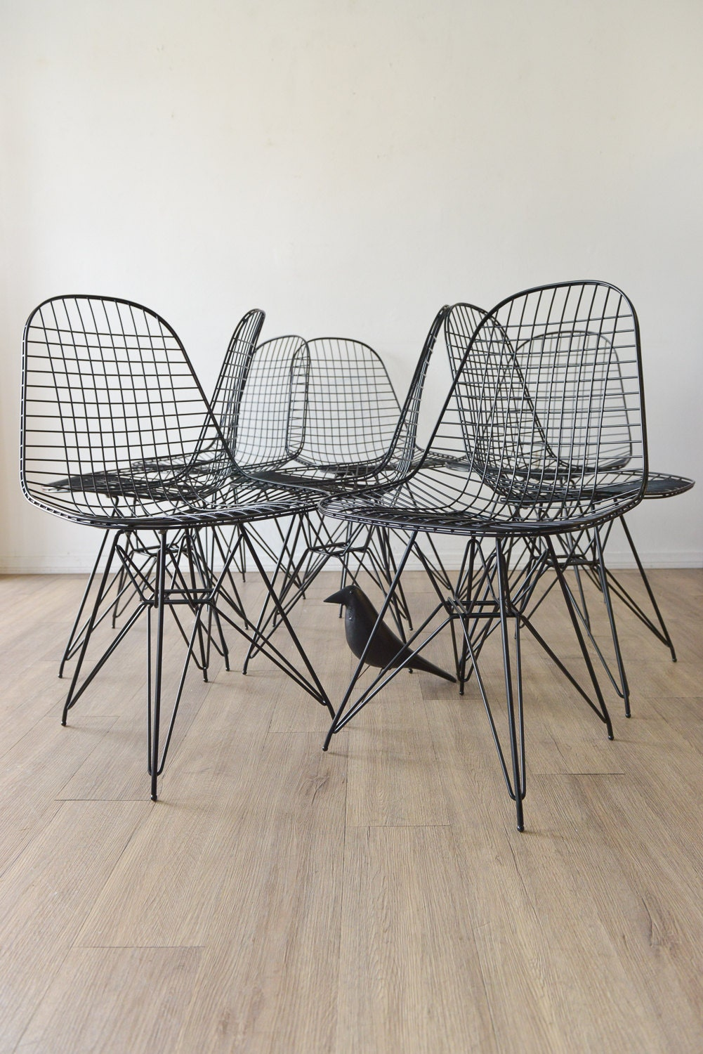 pair of original eames dkr mesh chairs in black by