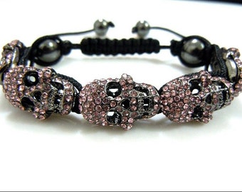 Pink and Gun Black Skull heads Bracelet With Express Shipping