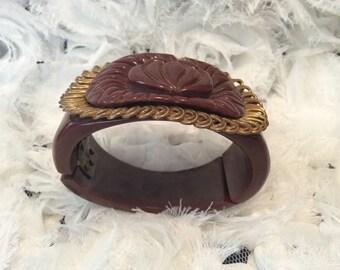 Vintage Brown Carved Bakelite Clamper with Goldtone Accent