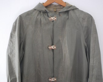 Army Raincoat fastened with metal clasps