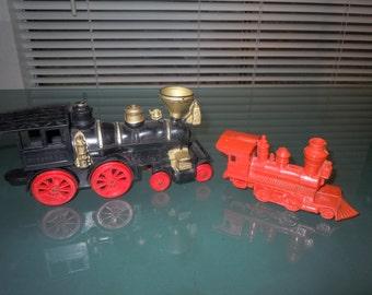 1960s Black Auburn Rubber co Locomotive and a Red Elmar hard plastic Locomotive