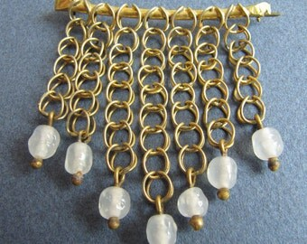 Vintage brass brooch with small chains and glass beads
