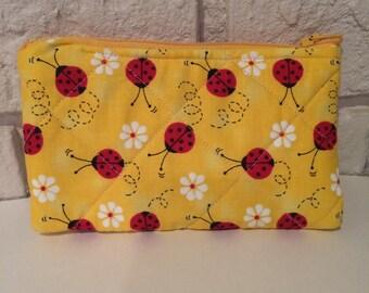 Ladybug on yellow coin purse
