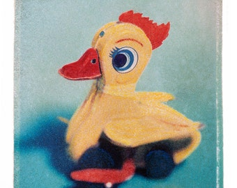 Fine Art photograph of Polaroid Transfer of vintage  Toy Yellow Duck