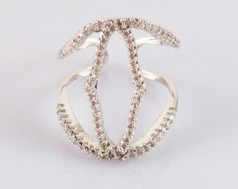 Ring adjustable back, stainless steel with elongated motif and outlined with cubic zirconia pave style.  .