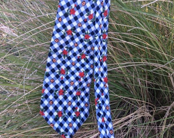 Men's vintage necktie 80s from Structure. Navy blue with checkered Pattern of red, white, blue and yellow flowers, silk