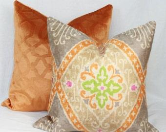 "Iman orange & gray velvet pillow. 20"" x 20"". 22"" x 22"". 24"" x 24"". 26"" x 26""."