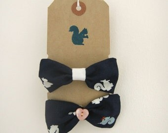 White and pale blue squirrels on navy background hair bows