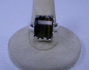 This ring is a very nice tiger eye size 8 3/4.