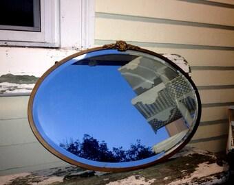 Vintage brass industrial beveled mirror