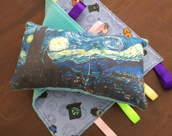 """A tag blanket with a print of whovian baby characters, and a little pillow with """"A Starry Night"""" plus Tardis."""