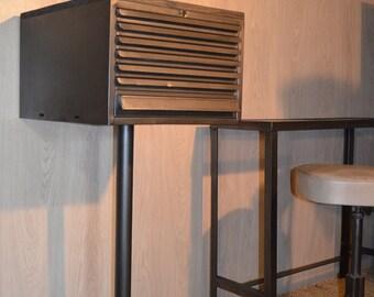 Minimalist industrial storage drawers unit on foot