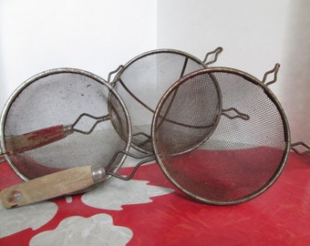 Three Wooden Handled Metal Strainers