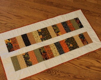 Quilted table runner with harvest prints