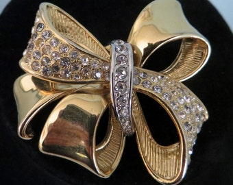 Gold and paved Rhinestone ribbon bow brooch signed