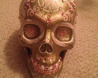 Hand painted plastic sugar skulls with rhinestones with movable jaws