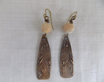 Raven bronze clay earrings with mother of pearl beads