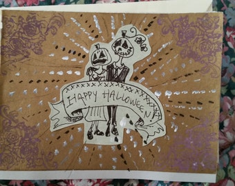 "4"" x 5 1/2"" handmade Halloween card, featuring a jack-o-lantern couple on the front."