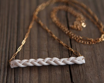 25% Sale - (was 74) white porcelain braid  - varied gold chain necklace