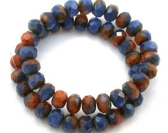 Denim blue and burnt orange opal opaque swirl  6 x 9mm rondelles. Set of 12 or 25.