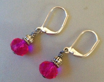 Earrings in antique silver with pink beads with lever back wires.  AS0130